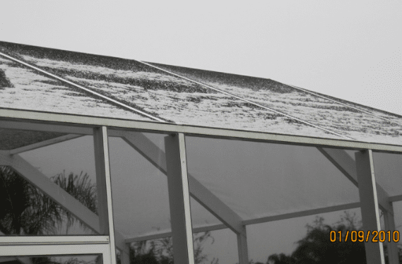 """Snow"" on my neighbor's pool enclosure here in Florida. Winter 2010. Brrr."
